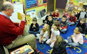 A Read Aloud West Virginia volunteer reads to elementary school students.